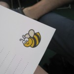 Deceptively friendly bee on the spelling test answer sheet