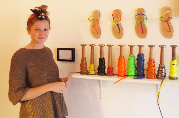 Francesca with the colourful bolts of leather straps